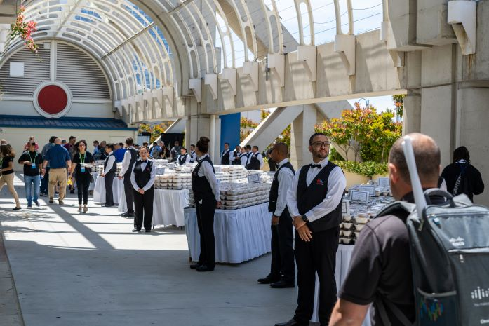 Food & beverage staff ready to serve attendees boxed lunches