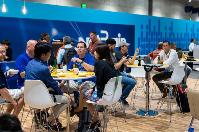 Guests enjoying meal in exhibit hall