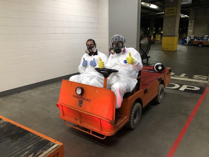Staff in motorized cart