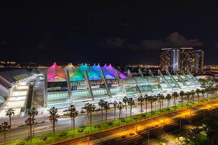 San Diego Convention Center at night with Sails Pavilion colored