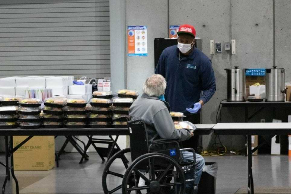 Shelter resident receives a Centerplate meal